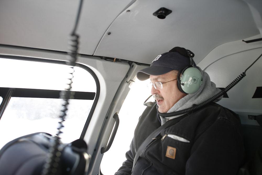 John Lippert in helicopter over Ft McMurray Oil Sand Developments