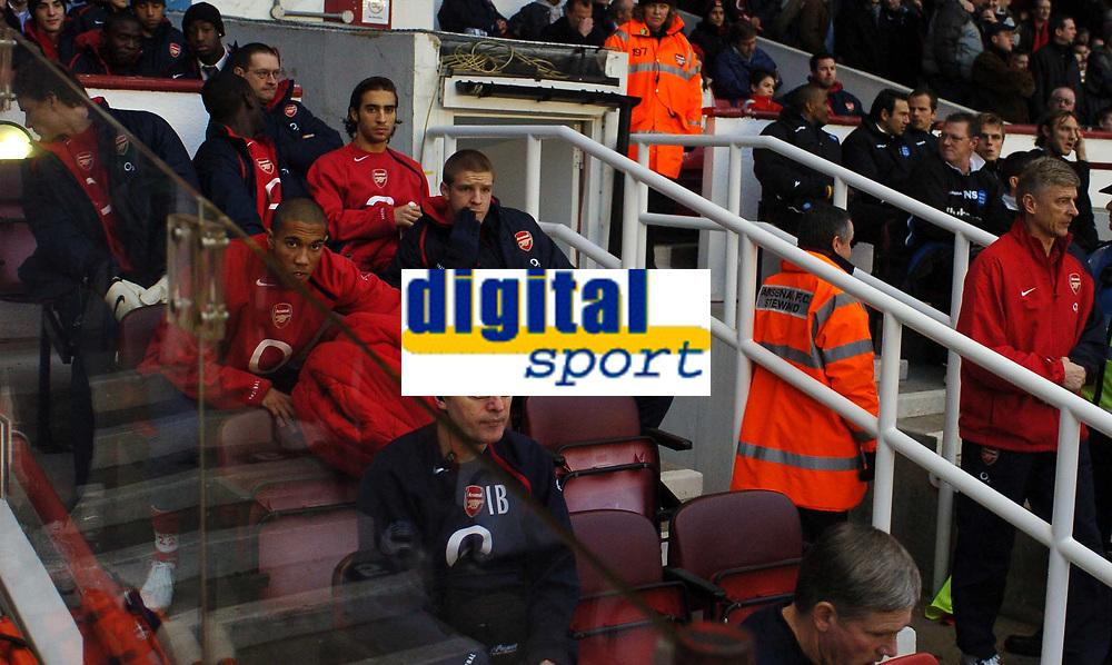 Jens Lehmann, far left, turns away as Arsene Wenger emerges from the tunnel