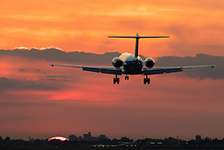 London Heathrow, September 19th 2015. AKLM Royal Dutch Airlines Fokker 70 lands as the sun sets on London's Heathrow Airport.