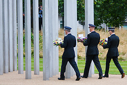 Hyde Park, London, July7th 2015. The Mayor of London Boris Johnson and other senior political figures, the Commissioners for transport and policing in the capital, as well as senior representatives of the emergency services  lay wreaths at the 7/7 memorial in Hyde Park. PICTURED: Police Commissioners prepare to lay their wreaths.
