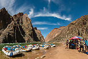 """Lunch at Below Clear Creek Camp (River Mile 84.8) in the Inner Gorge. Day 6 of 16 days rafting 226 miles down the Colorado River in Grand Canyon National Park, Arizona, USA. Multiple overlapping photos were stitched to make this panorama. For this photo's licensing options, please inquire at PhotoSeek.com. """"The rocks of the Vishnu Formation, predominantly mica schists, are the oldest in the Grand Canyon. Approximately 2 billion years ago, 25,000 feet of sediments were deposited and volcanics extruded onto the ancient sea floor. During an orogeny, a mountain-building episode, 1.7 billion years ago, those rocks were folded, faulted, and uplifted (metamorphosed), and intruded by the Zoroaster Formation, predominantly granite (also subsequently metamorphosed to form granite gneiss). The resulting mountain range is believed to have been 5-6 miles high. Over the next 500 million years, the mountains were eroded until only their roots remained, and today, the roots of those mountains form the steep walls of the inner gorge."""" - geologistwriter.com"""