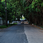 Old car from the Soviet era driving at a quit area of Vedado.