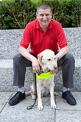 Vision impaired man with his guide dog,