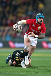 British and Irish Lions' Jack Nowell gets away from Hurricanes' Nehe Milner-Skudder during the tour match at the Westpac Stadium, Wellington.
