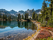 The Sawtooth Range reflects in Alice Lake in Sawtooth Wilderness, Idaho, USA. On October 6-7, 2020, starting from Tin Cup Trailhead, I hiked the Alice-Toxaway Loop clockwise for 20 miles including an overnight stay at idyllic Twin Lakes. The first day to Twin Lakes was a moderate 7.4 miles with 2090 feet gain. The second day returned via Toxaway Lake and Farley Lake for 12.5 miles with 1260 feet up and 2940 feet down. For the most dramatic scenic build-up, I recommend backpacking 3 days counterclockwise staying at Toxaway Lake then Twin Lakes. (On a 2007 backpacking trip in August, we enjoyed staying 2 nights at Alice Lake and day-hiked to Toxaway.) The Sawtooth Range (part of the Rocky Mountains) are made of pink granite of the 50 million year old Sawtooth batholith.