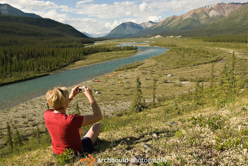 A canoeist takes a photograph of her Wind River campsite.<br /> <br /> NOT IN YOUR BUDGET? Contact Cathie for a price specific to your project.