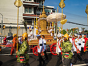 16 DECEMBER 2015 - BANGKOK, THAILAND: The funeral urn of Somdet Phra Nyanasamvara, who headed Thailand's order of Buddhist monks for more than two decades and was known as the Supreme Patriarch. He died Oct. 24, 2013, at a hospital in Bangkok and was cremated today. He was 100. He was ordained as a Buddhist monk in 1933 and appointed as the Supreme Patriarch in 1989. He was the spiritual advisor to Bhumibol Adulyadej, the King of Thailand when the King served as a monk in 1956. Tens of thousands of people lined the streets during the procession to pray for the Patriarch.     PHOTO BY JACK KURTZ
