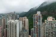 Hong Kong - August 26, 2019: High angle view of numerous high-rise apartment buildings in the Mid-Levels district of Hong Kong Island.