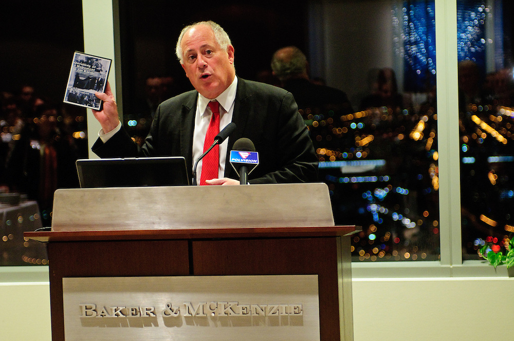 Illinois Governor Patrick Quinn boasts a copy of a film about one of his Georgetown professors titled Unveiling of a Monument to Jan Karski during a reception announcing the formation of the Jan Karski Educational Foundation on Monday, November 12th at the law offices of Baker & McKenzie LLP. Born in 1914, Karski was a member of the Polish Underground, a World War II resistance movement in occupied Europe. His undercover dispatches offered allied nations significant insight into Nazi atrocities, later detailed in his book Story of a Secret State and earning him a posthumous President Medal of Freedom in 2012. A team of Baker & McKenzie lawyers in Chicago and Warsaw helped to create the non-profit Foundation. © 2012 Brian J. Morowczynski ViaPhotosMorowczynski ViaPhotos
