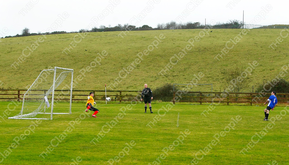 12/01/2014<br /> Gerard Dullaghan of Hermitage knocks a penalty kick past Lifford keeper Cormac Walsh to score the opening goal in the Premier League Clash at Cassidy Park, Drumcliffe, Ennis on Sunday.<br /> Picture: Don Moloney / Press 22