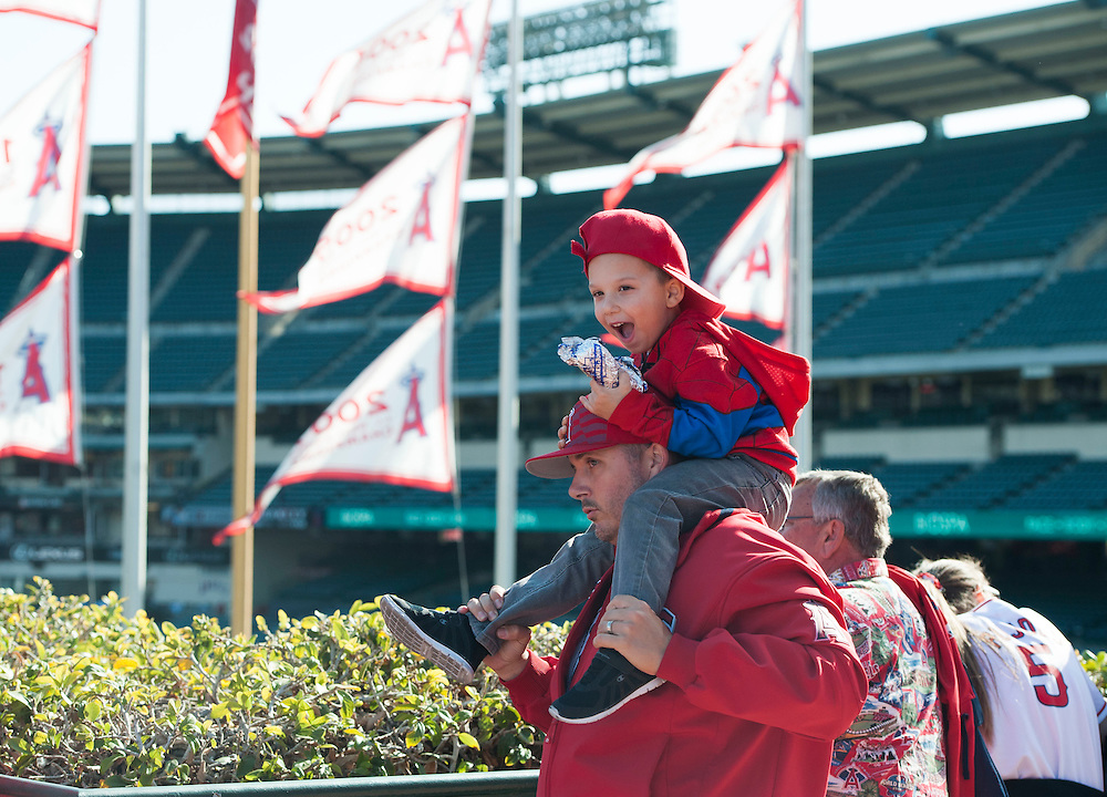Angel fans Jeff Carlson and his four-year-old son Tristen, of Eastvale enjoy the Angels' Halo Honk event Wednesday at Angel Stadium.<br /> <br /> ///ADDITIONAL INFO:   <br /> <br /> angels.0428.kjs  ---  Photo by KEVIN SULLIVAN / Orange County Register  --  4/27/16<br /> <br /> The Los Angeles Angels take on the Kansas City Royals Wednesday at Angel Stadium.<br /> <br /> <br />  4/27/16