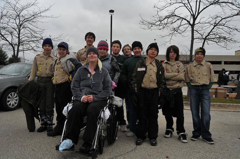 Jessica Paredes age 32 (front) and her daughter Alyssa Moore age 12, with scouts from troop 580 at Good Neighbor Day, Saturday Nov. 15 2008.  The program at this site was organized by boy scout Andrew Stiles, age 16, who has been diagnosed with muscular dystrophy, a disease that causes progressive muscle weakness.