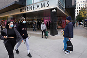 Asthe national lockdown ends and the new three tier system of local coronavirus restrictions begins, shoppers head out to Oxford Street to catch up on shopping as non-essential shops like Debenhams which has just announced that the department store chain will be closing down for good are allowed to reopen on 2nd December 2020 in London, United Kingdom. Debenhams has been an ever present feature all over the UK for 242 years, but it has been announced that it will close all of its shops at the cost of around 12,000 jobs, and go into liquidation. This huge blow to the high street has not come as a surprise as the company has been struggling for some time.