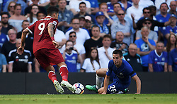 Liverpool's Roberto Firmino and Chelsea's Cesar Azpilicueta battle for the ball
