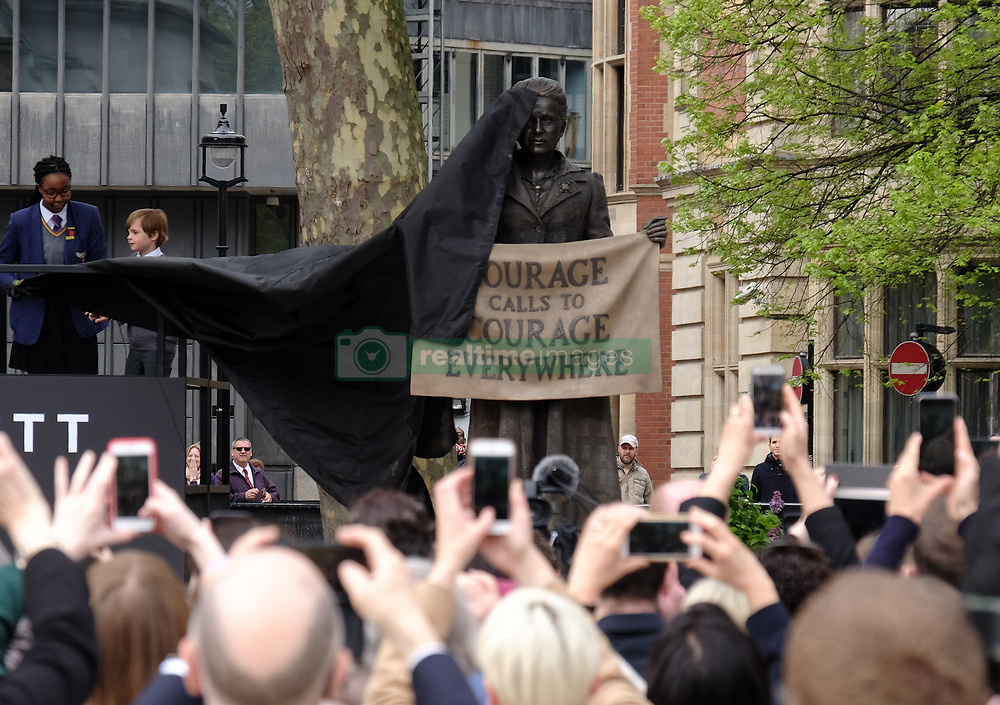 April 24, 2018 - London, England, United Kingdom - A statue in honour of the first female Suffragist Millicent Fawcett is unveiled during a ceremony in Parliament Square on April 24, 2018 in London, England. The statue of womenÂ's suffrage leader Millicent Fawcett is the first monument of a woman and the first designed by a woman, Turner Prize-winning artist Gillian Wearing OBE, to take a place in parliament Square. (Credit Image: © Jay Shaw Baker/NurPhoto via ZUMA Press)