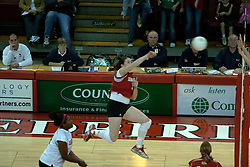 06 November 2004....Laura Doornbos swings to kill.....Illinois State University Redbirds V SouthWest Missouri State University Bears Volleyball.  Redbird Arena, Illinois State University, Normal IL..Illinois State Redbirds v Southwest Missouri State