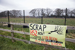 A banner calling for the scrapping of the HS2 high-speed rail link project is pictured in front of works to fell a row of hundred-year-old oak trees in Leather Lane on 18th March 2021 in Great Missenden, United Kingdom. Almost 40,000 people have recently signed a petition calling for the oak trees lining the ancient country lane not to be felled to make way for a temporary haul road and construction compound and local residents and conservationists have accused HS2 contractors of destroying active bird boxes on the site.