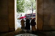 London, United Kingdom, May 18, 2021: People rush to take cover in Trafalgar square as heavy rain hits central London on Tuesday, May 18, 2021. (Photo by Vudi Xhymshiti/VXP)