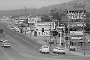 383D-06.  Pacific Village Shopping Center, Newport. Oregon. Highway 101 looking north from 6th. September 1971