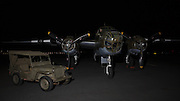 Jeep and North American B-25 Mitchell at night.