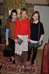 Left to right, NURA KHAN, SERENA HOOD and SOPHIE GOODWIN at a ladies lunch hosted by Katie Readman for sisters Lucia & Rosie Ruck Keene founders of a new fashion label - Troy, held at 5 Hertford Street, London on 27th January 2015.