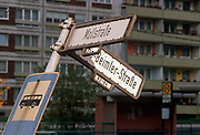 Months after the fall of the Berlin wall and the collapse of the communist GDR state the German Democratic Republic, bent street signposts still remain, on 15th June 1990, in Berlin, Eastern Germany.