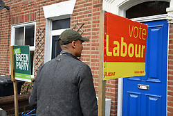 Clive Lewis, Labour MP for Norwich South, canvassing in Norwich 2 days before the local elections. 2 May 2017. UK. This house has both Labour Party & Green Party signs