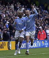 Photo. Glyn Thomas.<br /> Manchester City v Tottenham Hotspur. FA Cup fourth round. <br /> City of Manchester Stadium, Manchester. 25/01/2004.<br /> Man City's Nicolas Anelka (L) celebrates with Antoine Sibierski after putting his side 1 goal ahead.