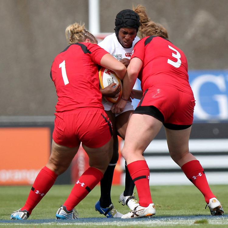 Maggie Alphonsi tackled. England v Canada Pool A match at WRWC 2014 at Centre National de Rugby, Marcoussis, France, on 9th August 2014