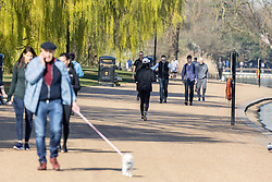 © Licensed to London News Pictures. 29/03/2021. London, UK. Runners and walkers enjoy the sunshine in Hyde Park, London as weather forecasters predict the hottest March in over 50 years with highs of 23c in London and the South East today. From yesterday, two households or six people are now allowed to meet up marking the end of the Stay at Home advice. Playing golf, tennis and organised outdoor sports is also allowed as England starts to unlock after a year of Covid-19 restrictions. Photo credit: Alex Lentati/LNP