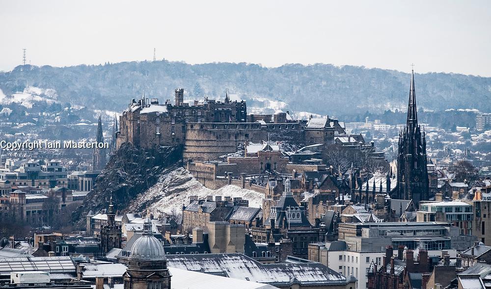 Edinburgh, Scotland, United Kingdom. 29 December, 2017; Snow falls on Edinburgh enhancing views of the city. Edinburgh Castle viewed from Salisbury Crags.