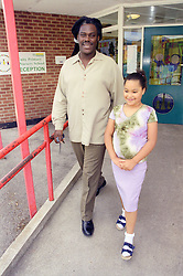 Single father collecting young daughter from primary school,
