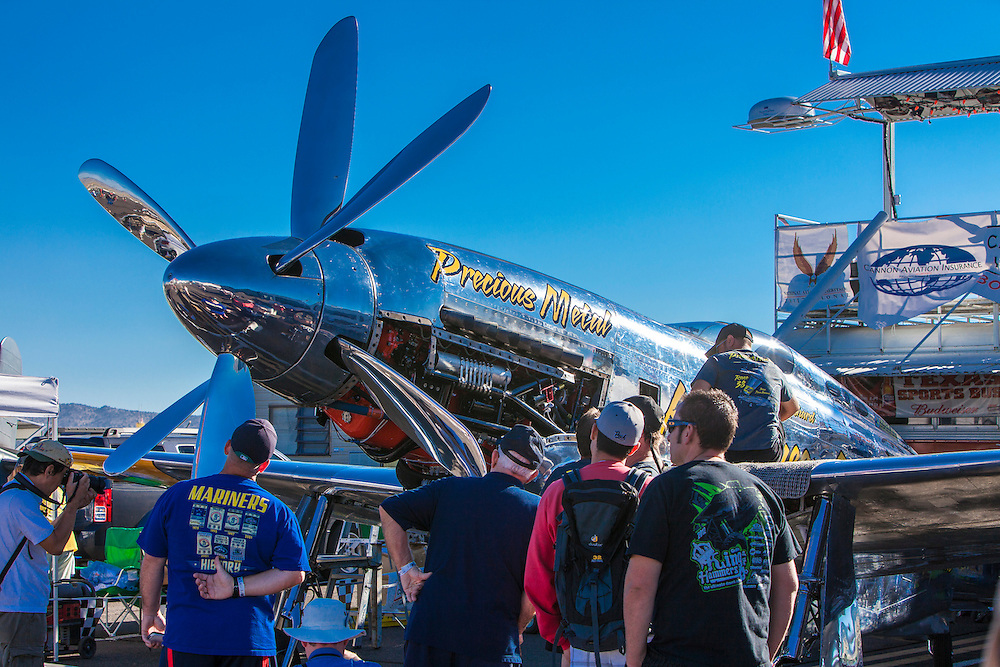 """""""Precious Metal"""", a highly modified P-51 Mustang with counter-rotating propellers, in the pits at the 2012 Reno Air Races."""