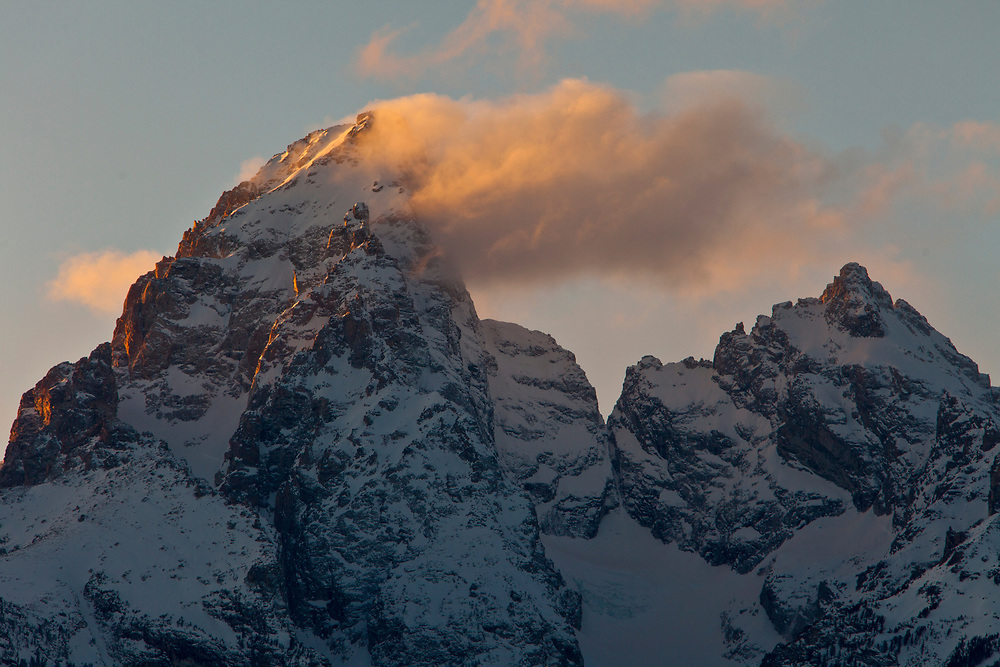 Open Edition Numbered Prints<br /> The Grand Teton at 13770 feet and Mount Own at 12928 feet create their own weather pattern for the last sunlight to catch on a cold winters evening near Jackson Wyoming