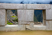 Precisely cut stone blocks at the ancient site of Machu Pichu in the Cusco region of Peru. Note how the stones fit together almost perfectly without cement or mortar. These stones were of course cut long before the invention of machinery.