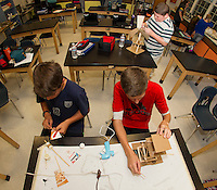 Lucan Mathieu and Dylan Greer work together on their windmill engineering project in Mr. White's 8th grade class at Belmont Middle School Wednesday morning.  (Karen Bobotas/for the Laconia Daily Sun)