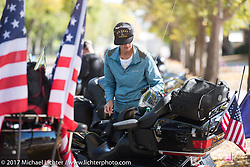 Sara Cress, a USN Veteran at a stop in Pierre during the USS South Dakota submarine flag relay across South Dakota on the first day from Sturgis to Aberdeen. SD. USA. Saturday October 7, 2017. Photography ©2017 Michael Lichter.