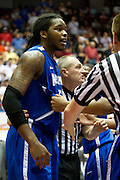 Shaq Goodwin #5 of the Memphis Tigers is restrained by the refs after a flagrant 2 foul against the SMU Mustangs at Moody Coliseum on Wednesday, February 6, 2013 in University Park, Texas. (Cooper Neill/The Dallas Morning News)