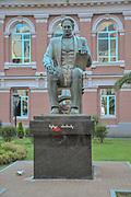 Memed Abashidze statue and Constitutional Court of Georgia in old town Batumi, Georgia. Memed Abashidze was a Georgian politician, writer. The statue was built on September 19, 2014 in Batumi by Georgian sculptor Elguja Amashukeli.