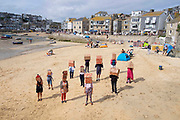 First Homes Not Second Homes protest on the 11th of September 2021 in St Ives, Cornwall, United Kingdom. First NOT Second Homes FNSH launched the campaign today with an action which seeks to involve other communities across the UK to bring about a lasting and meaningful change in the housing crisis. There is no housing shortage, but there is a housing distribution crisis. The protesters live in various locations in the far Southwest of the county, and recognise that the Southwest is the worst affected area for second home ownership and its detrimental effects when they are used solely for holiday lets and through AirBnB. Much of the profit from these properties leaves the host communities and does little to support the local economy.