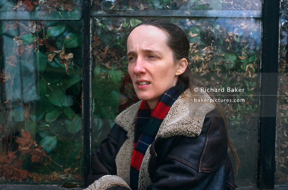Writer Alison (A L) Kennedy leans against the old Victorian windows of Glasgow's Botanical gardens, in Scotland. Looking serious and rather troubled, she is wearing a worn leather jacket and a tartan scarf, she looks towards the ground during her portrait session for Stern Magazine. A L Kennedy is one of Britain's most respected novelists, dramatist, newspaper columnists and more recently, stand-up comedian after her 2007 performances at the Edinburgh festival. Her books include: Paradise; Indelible Acts; On Bullfighting; Everything You Need; Original Bliss; So I Am Glad; Looking for the Possible Dance;  Night Geometry & the Garscadden Trains; Now That You're back and Life & Death of Colonel Blimp. Born in Dundee on 22nd October 1965, she was educated at Dundee High School 1970 - 1983 & Warwick University 1983 - 86 (BA Hons in Theatre Studies & Drama).