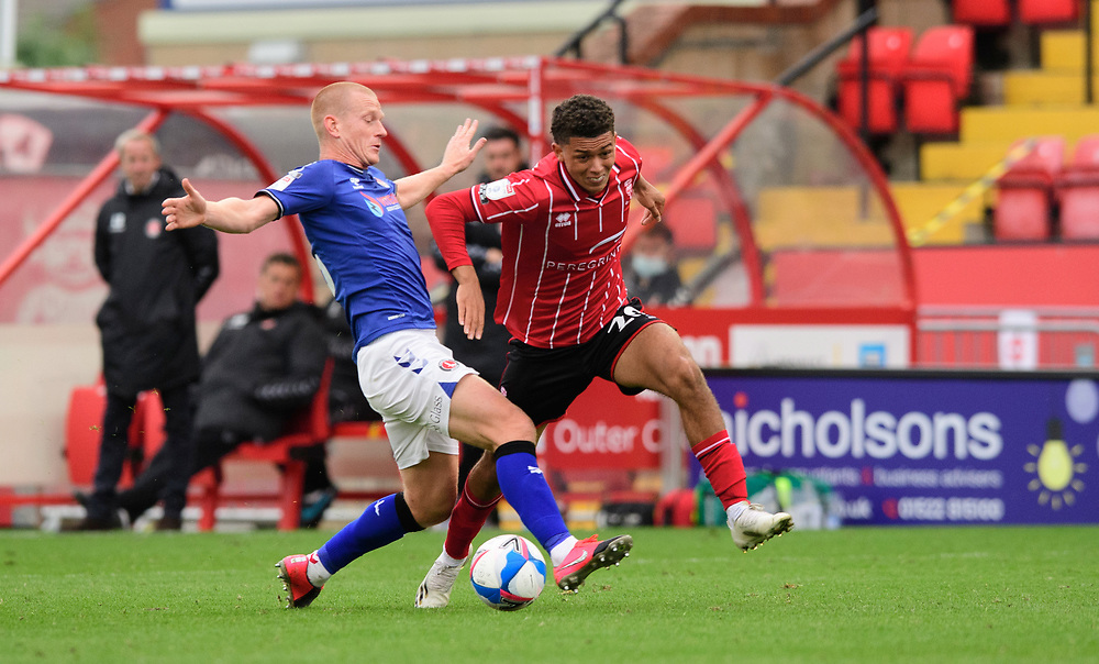 Lincoln City's Brennan Johnson vies for possession with Charlton Athletic's Ben Watson<br /> <br /> Photographer Chris Vaughan/CameraSport<br /> <br /> The EFL Sky Bet League One - Lincoln City v Charlton Athletic - Sunday 27th September, 2020 - LNER Stadium - Lincoln<br /> <br /> World Copyright © 2020 CameraSport. All rights reserved. 43 Linden Ave. Countesthorpe. Leicester. England. LE8 5PG - Tel: +44 (0) 116 277 4147 - admin@camerasport.com - www.camerasport.com