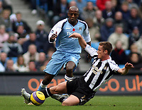 Photo: Paul Thomas.<br /> Manchester City v Newcastle United. The Barclays Premiership. 11/11/2006.<br /> <br /> Man City's Hatem Trabelsi (blue) goes past the sliding tackle of Scott Parker.