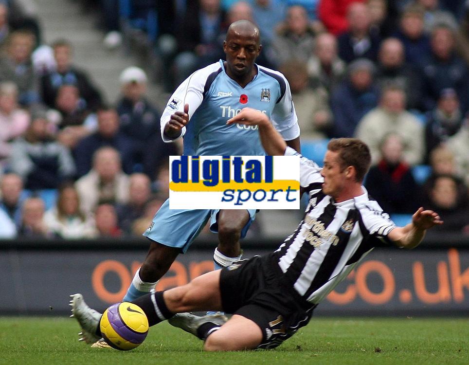 Photo: Paul Thomas.<br /> Manchester City v Newcastle United. The Barclays Premiership. 11/11/2006.<br /> <br /> Man City's Hatem Trabelsi (blue) goes past the sliding tackle of Scott Parker.