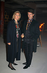 COUNT & COUNTESS MANFREDIE DELLA GHERARDESCA  at an exhibition of work by Rolf Sachs - a unique world-renowned contemporary furniture designer, held in association with the Louisa Guinness Gallery and held at 250 Brompron Road, London on 6th October 2004.<br />