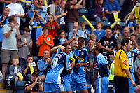 Photo: Alan Crowhurst.<br />Wycombe Wanderers v Lincoln City. Coca Cola League 2. 23/09/2006. Tommy Mooney of Wycombe (2nd L) celebrates his goal.