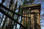 Rusting wrought iron gates of private property at the entrance of an old estate, on 25th March, in Everberg, Brabant, Belgium.