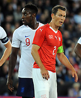 Football - 2018 / 2019 International Friendly - England vs. Switzerland<br /> <br /> Danny Welbeck of England and Stephan Lichtsteiner of Switzerland who both play for Arsenal, at King Power Stadium.<br /> <br /> COLORSPORT/ANDREW COWIE