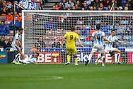 Chris Wood of Leeds united (9) shoots and scores his teams 2nd goal. Skybet football league Championship match, Huddersfield Town v Leeds United at the John Smith's Stadium in Huddersfield, Yorks on Saturday 7th November 2015.<br /> pic by Chris Stading, Andrew Orchard sports photography.