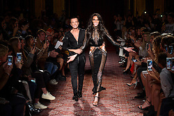 PABest Model Winnie Harlow on the catwalk with designer Julien Macdonald during the Julien Macdonald Autumn/Winter 2017 London Fashion Week show at Goldsmith's Hall, London.